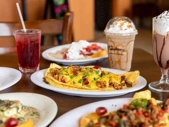 omelets eggs benedict coffe and drinks on table at the pancakery destin panama city beach fl